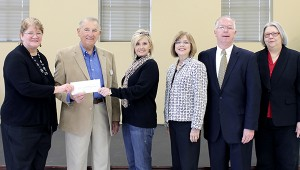 Submitted The gift of knowledge: Pearl River County Library System director Carol Phares, left, accepts a grant check from Dr. Ted Alexander, CEO of the Lower Pearl River Valley Foundation, and Stacy Wilkes, president of the Rotary Club of Poplarville. With them are EDC Educational Services consultants Kay and Bob Rhett and Cynthia Hornsby of the Poplarville Library.