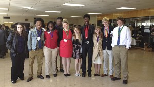 From left,  Annika Sanders, Kiandre McMillian, Arianna Malley, De Jon Stallings, Kimi Herring, Claudia Hampton, Chaunn Davidson, Sydney Varnado, Sidney Albritton, Jonathan Heberg pose with their medals at the DECA District competition.  Photo submitted.