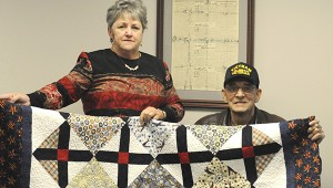 Alexandra Hedrick | Picayune Item Quilt of valor: Veteran's Service Department of Pearl River County representative Cindy Smith and Retired Air Force veteran Dale Flora, display the Quilt of Valor that he was presented with for service in the armed forces. Photo by Alexandra Hedrick