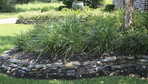 Photo by MSU Ag Communications/Gary Bachman STONE – Using stone or brick to contain a raised bed makes a decorative border that keeps the landscape tidy.
