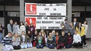 Alexandra Hedrick | Picayune Item  The champs: Members of High Tide Productions drama troupe brave the sleet as they sit beneath their championship banner which has been added to that of the football team.