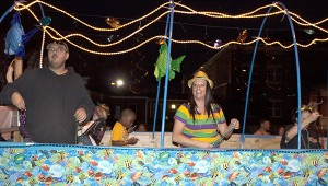 Valerie Lane Dorn is having a great time on the Wet and Wild Fun Jump float at Monday's Krewe of the Pearl Mardi Gras Parade. Jodi Marze   Picayune Item
