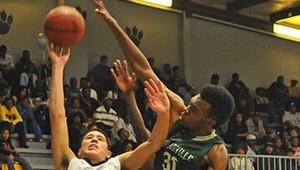 TOP TIGER: Moss Point Prep All-American Devin Booker goes up for a shot as Poplarville's Emetric Fells challenges the shot Friday night. Photo by Tyler G. Myers of The Mississippi Press