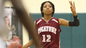 BIG SHOT: Picayune's Jada Simmons hit a big 3-pointer in double overtime to pace the Lady Tide to a win over Stone County Tuesday night. Photo by James Pugh