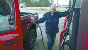 FILLING UP: Pearl River County resident Tudye Fountain fills the tank on her vehicle at a local gas station Tuesday morning. With prices of fuel rising, Fountain is concerned about her monthly budget. Photo by Jeremy Pittari