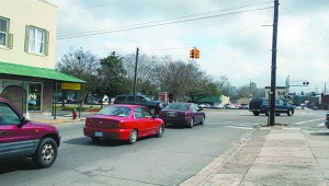 SIGNAL STAYING: Cars are lined up down West Canal waiting for the light to change. The city recently completed a traffic count at this intersection to help it determine any changes that may need to be made in the traffic signal's timing. Photo by Will Sullivan