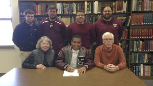 SIGNED UP: Picayune senior standout Mark Wood has signed a baseball scholarship with East Mississippi Community College. Wood, a pitcher who also sees time in the infield, helped guide the Maroon Tide to the Class 5A South state finals last season before Picayune fell to defending state champion Pascagoula in three games. Pictured are (seated, from left) Marie Wood (mother) Mark Wood and John Wood (father) as well as (standing, from left) Kyle Dillard, Tide assistant coach Drew Esslinger, Picayune head coach Cayne Stockstill and Tide assistant coach Cody Stogner. Picayune opens the season today against Poplarville in Carriere. Submitted photo