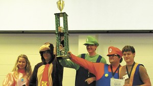 MOVING ON UP: From left, Kaitlyn Barber, Austin Stampley, Stephen Mitchell, Rob Merrell and Ben Jones of Poplarville High School show off their trophy after winning the Hurricane Bowl. The Fish Fighters will go on to compete in Seattle, Washington Photo submitted