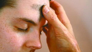 SIGN OF THE CROSS: Blessed ashes are used to make the sign of the cross on the foreheads of those who participate in Ash Wednesday. File photo