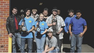 CREATIVE MECHANICS: Picayune Career and Technology Center automotive service  technology students created trophies for the marching band's fundraiser on Saturday.  Photo by Alexandra Hedrick