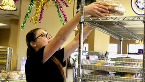 Goodness Galore: Paul's Pastry employee Alyssa Frierson stacks freshly made king cakes for store customers as thousands are being loaded out back in a container for shipping around the United States. Crews worked through out the night to have  enough of the Mardi Gras staple to meet customer demand. Jodi Marze | Picayune Item