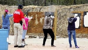 HOME AT THE RANGE: Pearl River County women practice shooting techniques under the watchful eye of Picayune Police Captain James Bolton. Jodi Marze | Picayune Item