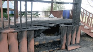 These charred boards on the gazebo at Friendship Park are the result of a fire that is suspected to be related to arson. The fire was reported after the park had closed. The fires occurred in the plastic garbage cans, two of which are visible in the background.