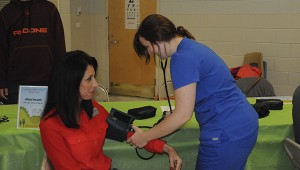 STAYING HEALTHY: Pearl River County School District Vocational Director Kelli Beech has her blood pressure taken by a Health Sciences student at Tuesday's Family Health Fair.  Photo by Alexandra Hedrick
