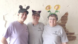 NAWLINS WITH A SMILE: From left, Sarah Hebert, Chemin Pitre and Mary Jo Marsh serve up New Orleans style cuisine with crazy headbands and a smile at Scooters on Main Street in Poplarville.  Photo by Alexandra Hedrick