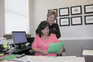 PREP WORK: Picayune Main Street Inc. manager Reba Beebe and Street Festival co-chair Eileen Baker prepare for this weekend's Street Festival. Photo by Jeremy Pittari